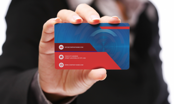 Free Holding Business Card Mock-Up